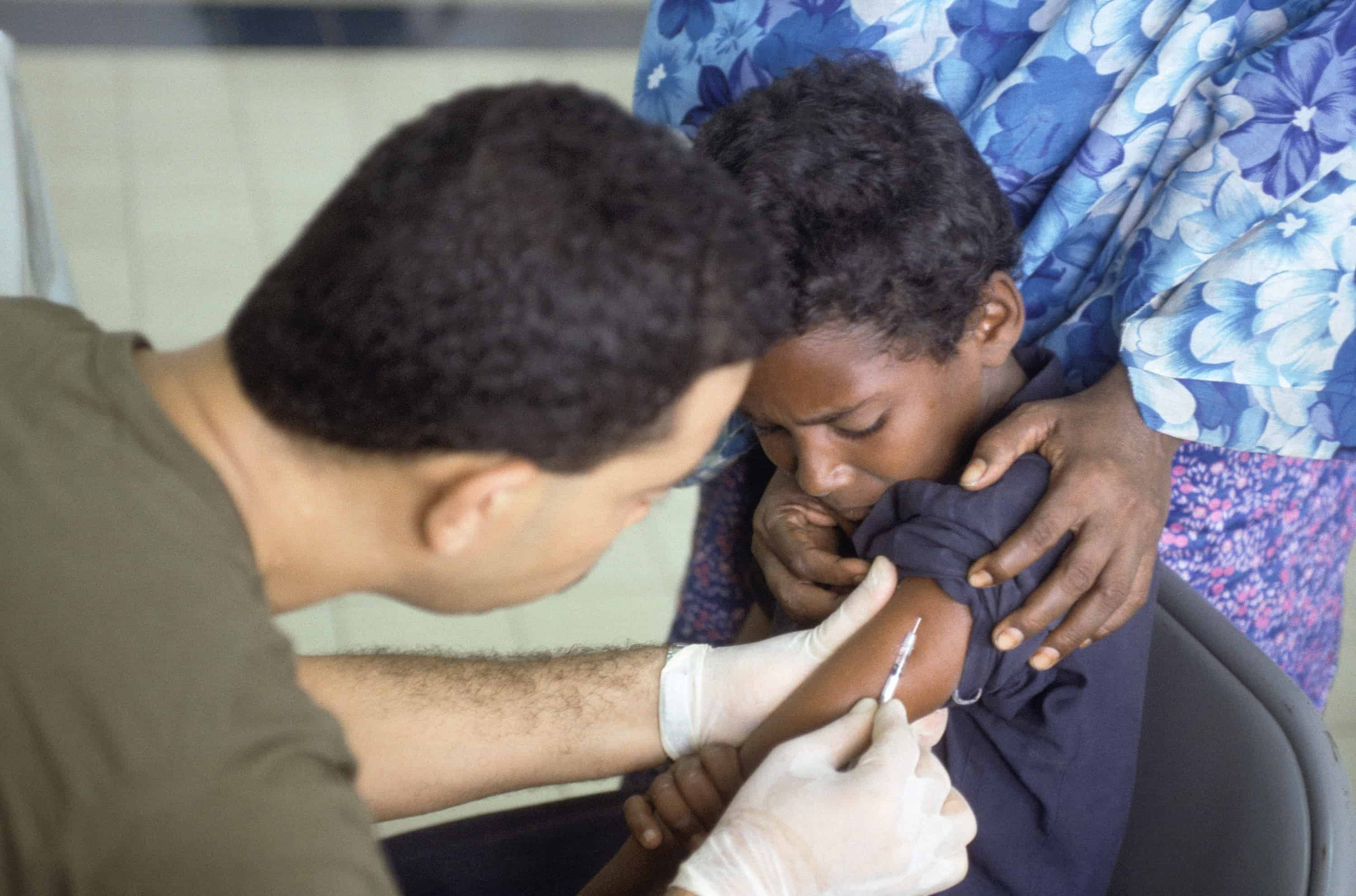 A Somali child receives a polio vaccination at the Tunisian hospital in Mogadishu.  The hospital treat local Somalis' diseases, malnutrition, and other injuries.